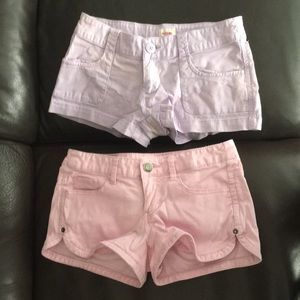 Bundle of pink shorts and purple shorts.